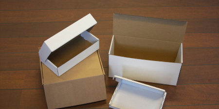 forsendelseskasser-2-1-450x225